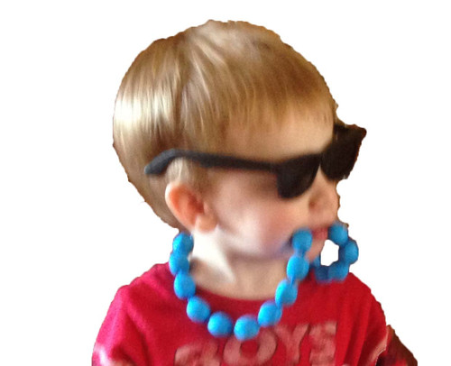 Silicone chewable teething necklace for toddlers or children with autism.