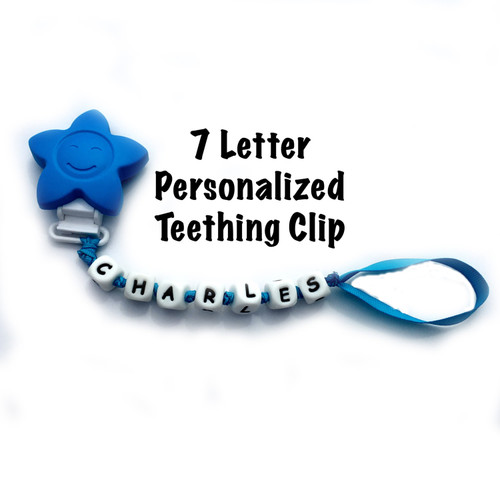 Silicone teething pacifier clip.