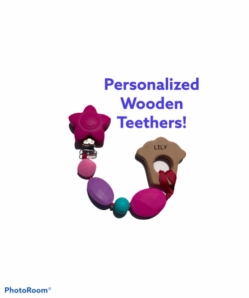 Personalized wooden teething clip.