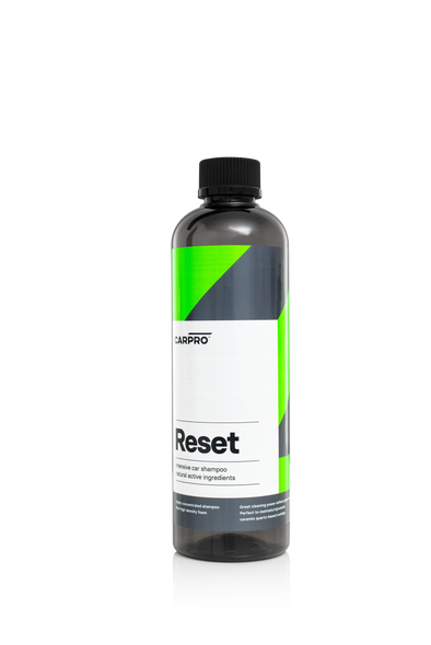 Dark grey 500ml bottle with black trigger sprayer and green, grey and white label reading CarPro Reset.