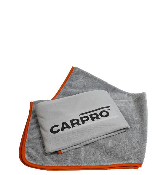 Grey microfiber drying towel with an orange edge and another towel folded on top showing the short pile side and the CarPro logo.