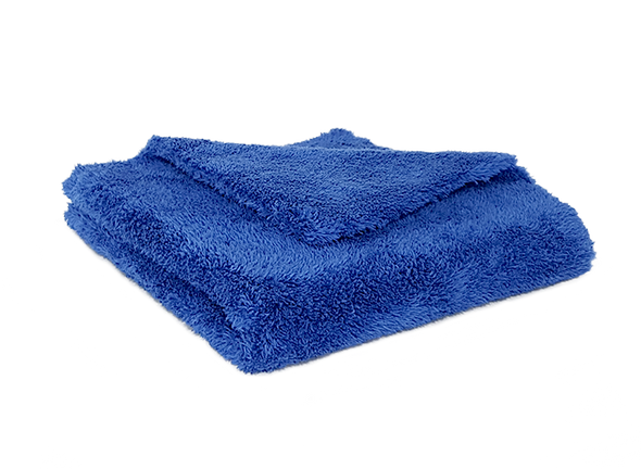Blue microfiber towel folded in 4 with another fold from the back showing the thickness of the towel.