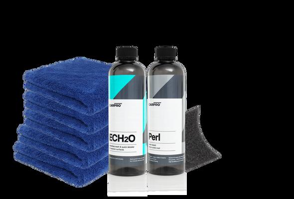 Bottle of ECH2O and a blue microfiber towel a bottle of perl a foam applicator behind it