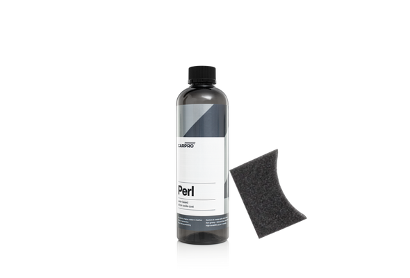 Bottle off CarPro perl with a grey label and a black foam applicator leaning on it.
