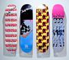 skateboard decks on wall