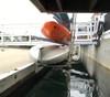 kayak dock rack hangs over the water