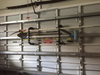 garage door storage rack for yard tools