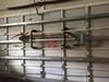 garage door storage rack for yard tools