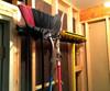 broom and shovel wall storage rack