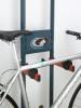 bike rack that leans against wall