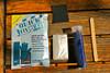 Quick Fix epoxy putty surfboard repair kit components sandpaper gloves applicator