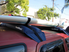 Soft and inflatable roof rack system for carrying stand up paddleboards