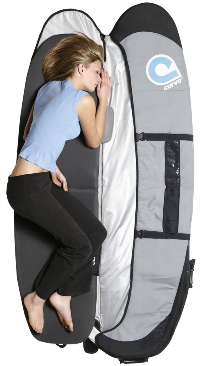 Sleep pad for surfboard travel bag