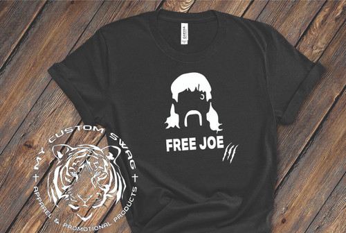 What kind of world is this without Joe Exotic prowling around (even though most of us just found out who he was)? Let's show our support for this entertainment if nothing else!!...FREE JOE!!  This is a 100% very soft, ring spun cotton. It is a UNISEX fit.  ***Light colored shirts will have black print***  Available in sizes S-4X.  Recommended Care Instructions: Machine wash warm, inside out, with like colors. Only non-chlorine bleach. Tumble dry low. Medium iron. Don not iron decoration. Do not dry clean.