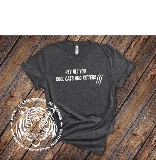 Hey all you cool cats and kittens! Love tigers? Love feuding adults who fight over tigers? This shirt is for you!!  This is a 100% very soft, ring spun cotton. It is a UNISEX fit.  Available in sizes S-4X.  Recommended Care Instructions: Machine wash warm, inside out, with like colors. Only non-chlorine bleach. Tumble dry low. Medium iron. Don not iron decoration. Do not dry clean.