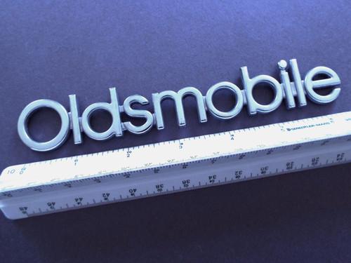 Original 1991-1992 Oldsmobile Custom Cruiser Tailgate Emblem-Nameplate-Badge