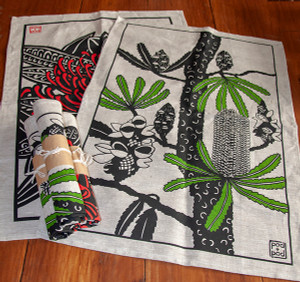 new banksia serrata tea towel shown here with tree waratah tea towel (sold separately).