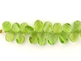 16 Count Varied Size Peridot Twist Faceted Pears (Sale)