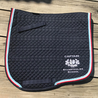 Stuartholme Saddle Pad. Cotton Quilted with rope trims and School Embroidery. There are a few different options listed in checkout, Jump or Dressage Style also some with sheepskin Extra Padding