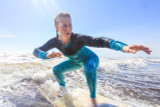 woman surfing rash guard