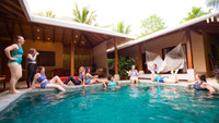 women in swimsuits in swimming pool