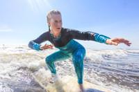 woman surfing rash guard