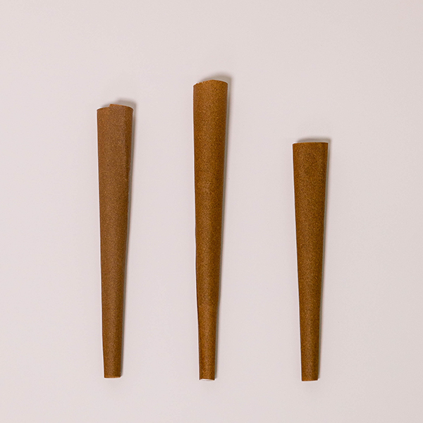 three pre rolled hemp wrap blunt cones over white background