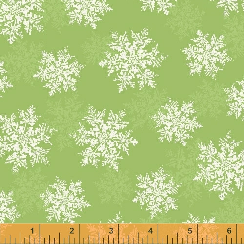 ASSORTED WHITE AND LIGHT GREEN SNOWFLAKES ON GREEN FABRIC