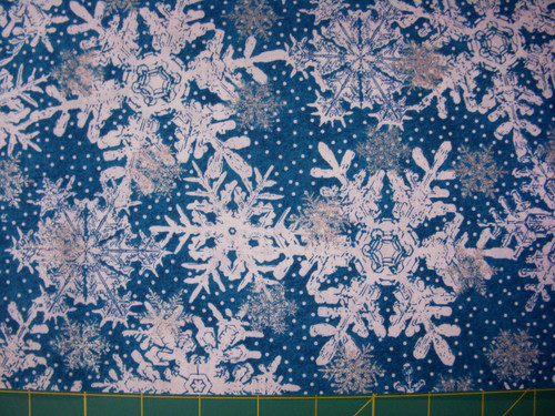 WHITE AND SILVER SNOWFLAKES ON BLUE FABRIC