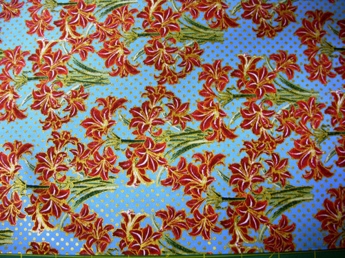 RED LILIES ON LIGHT BLUE FABRIC
