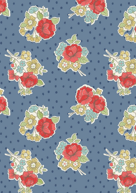 MULTI-COLORED PASTEL FLOWERS ON BLUE FABRIC WITH DARK BLUE POLKA DOTS