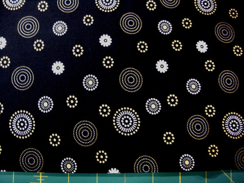 SMALL BLACK, YELLOW AND WHITE DESIGNS ON BLACK FABRIC