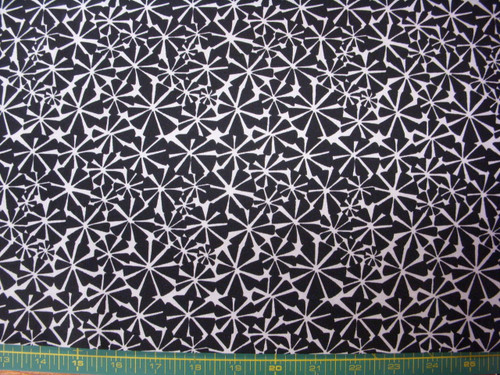 BLACK GEOMETRIC FLORAL DESIGN ON WHITE FABRIC