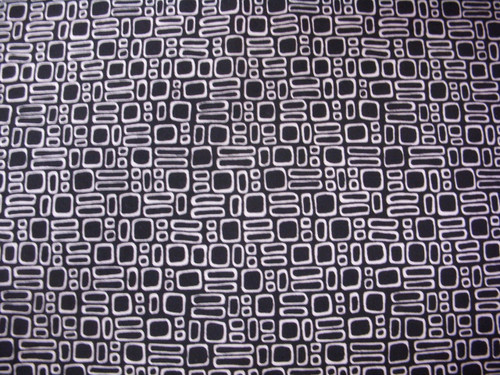 WHITE GEOMETRIC SHAPES ON BLACK FABRIC