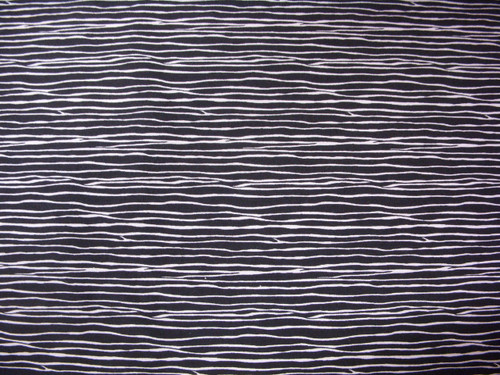 THIN WHITE SQUIGGLY LINES ON BLACK FABRIC