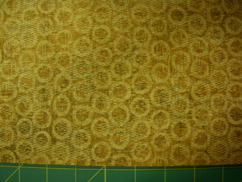 STONEHENGE GOLD TEXTURED-LOOK WITH LIGHTER GOLD CIRCLES FABRIC