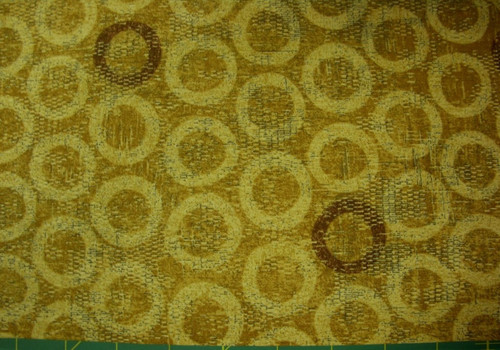STONEHENGE GOLD TEXTURED-LOOK WITH LIGHT GOLD AND BROWN CIRCLES FABRIC