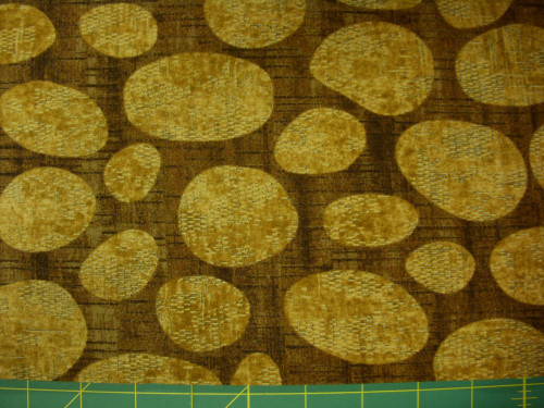 STONEHENGE BROWN TEXTURED-LOOK WITH OVALS ON GOLD FABRIC