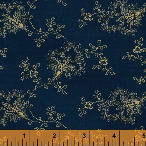 TAN FLORAL AND LEAF DESIGN ON BLUE FABRIC