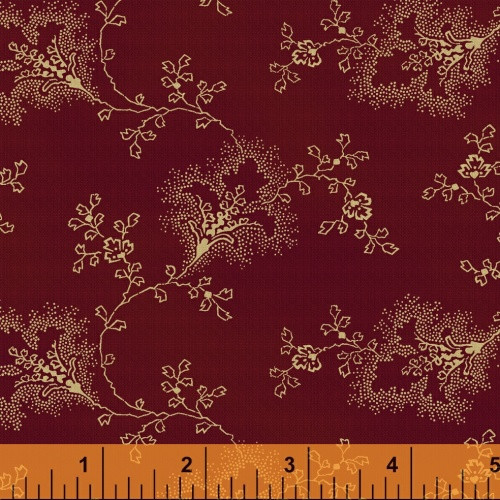 TAN FLORAL AND LEAF DESIGN ON RED FABRIC