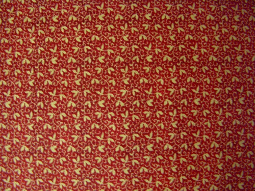 TAN LEAVES AND VINES ON RED FABRIC - 8247-008