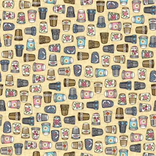 TOSSED MULTICOLORED DECORATIVE THIMBLES ON TAN FABRIC - 1649-24159-A