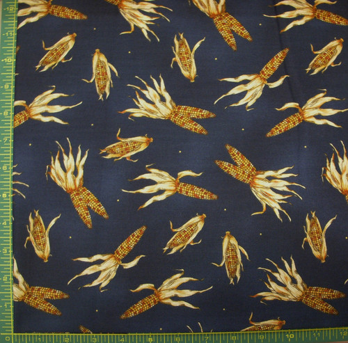 EARS OF CORN ON BLUE FABRIC