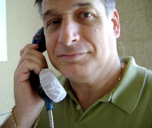 Man on Public Telephone