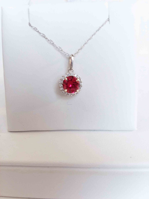"14K White Gold 6mm Round Created Ruby in a Halo of Cr. White Sapphires Pendant 18"" Chain"