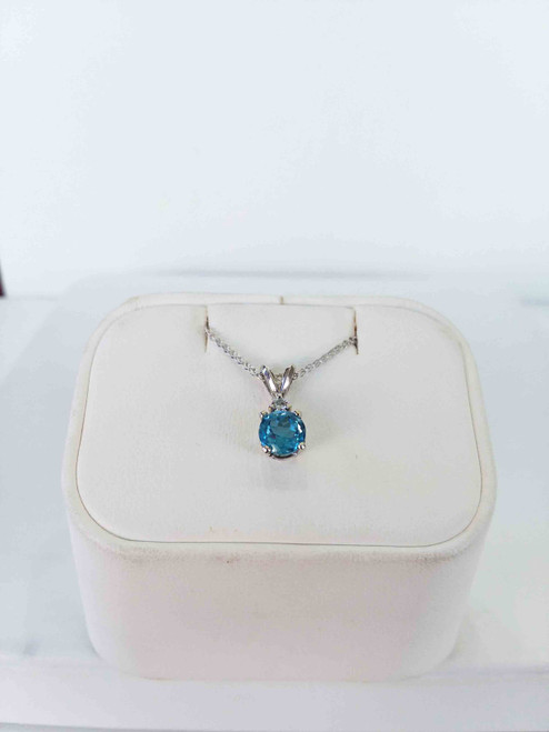 "14 kt White Gold Pendant with a diamond and Round Blue Topaz on a 18"" cable chain"