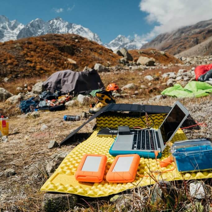 solar charging a laptop in Himalayas