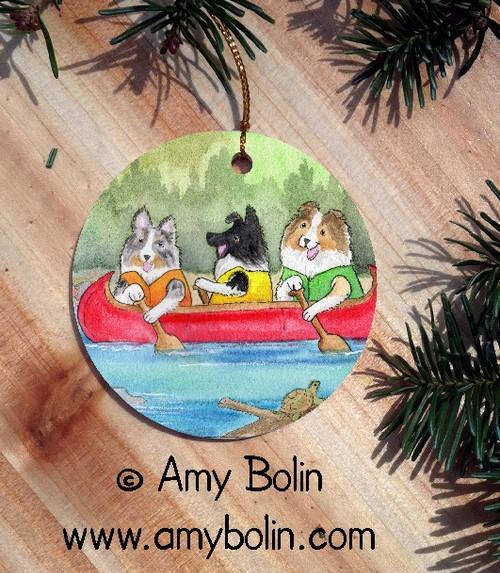 """Shelties On The River"" Bi Black, Blue Merle, Sable Shetland Sheepdog Ceramic Ornament Round"