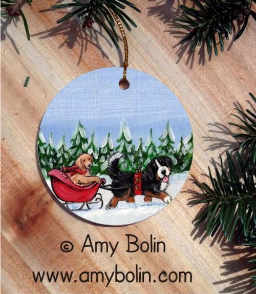 """A Wintry Ride"" Bernese Mountain Dog & Golden Retriever Ceramic Ornament Round"