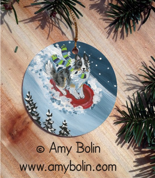 """The Sled Ride"" Blue Merle Shetland Sheepdog Ceramic Ornament Round"